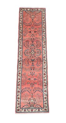 Lot 366 - Saroukh Runner  West Iran, circa 1960 The coral pink field with a column of flowering plants...