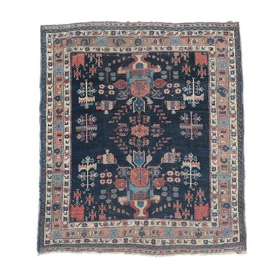 Lot 369 - Afshar Rug South East Iran, circa 1920 The indigo field with two urns issuing flowers enclosed...
