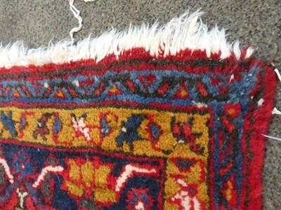 Lot 374 - Ahar Heriz Carpet Iranian Azerbaijan, circa 1950 The crimson field with flowerhead medallion...