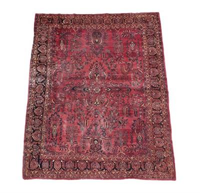 Lot 375 - Saroukh Carpet West Iran, circa 1930 The faded strawberry field of angular plants around a...