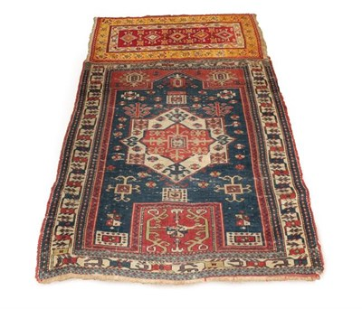 Lot 376 - East Caucasian Prayer Rug, circa 1890, the indigo field with central panel beneath the Mihrab...