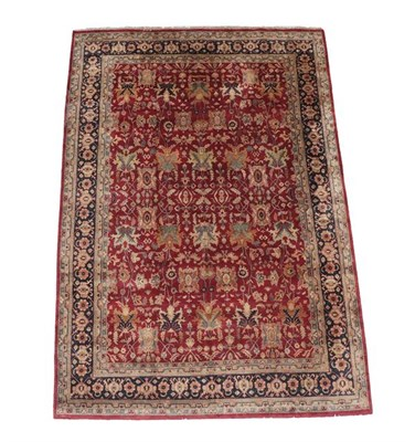 Lot 379 - Large Indian Carpet, modern The brick red field with an allover design of flowing vines and...