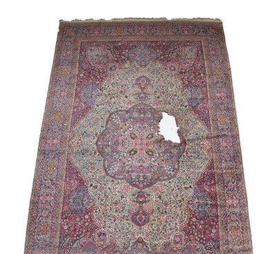 Lot 380 - Large Ravar Kirman Carpet South East Iran, circa 1925 The ivory field richly decorated with...