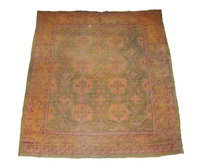 Lot 381 - Ushak Carpet Central/West Anatolia, circa 1900 The faded olive green field with columns of...