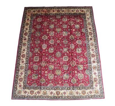 Lot 383 - Tabriz Carpet Iranian Azerbaijan, circa 1950 The deep raspberry field with an allover design of...