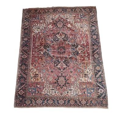 Lot 384 - Heriz Carpet Iranian Azerbaijan, circa 1920 The chestnut field of angular vines around an...