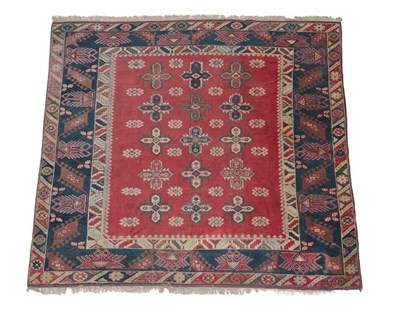 Lot 385 - Dosemalti Carpet of unusual size West Turkey, 2nd half 20th century The brick red field with...