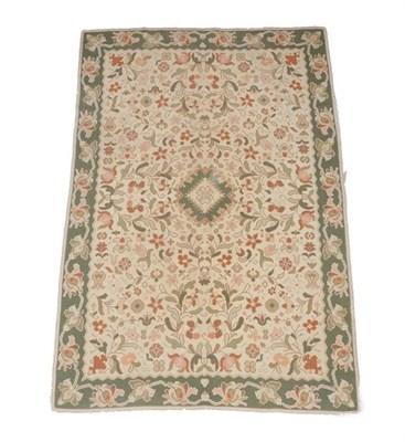 Lot 387 - Portuguese Flatweave Carpet, 2nd half 20th century The cream field of flowering plants around a...
