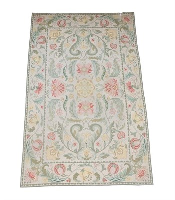 Lot 388 - Portuguese Flatweave Carpet, 2nd half 20th century The cream field of large scrolling floral...