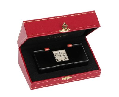 Lot 390 - A PVD Coated Les Pendulette Alarm Desk/Travelling Timepiece, signed Cartier, model: Les Pendulettes