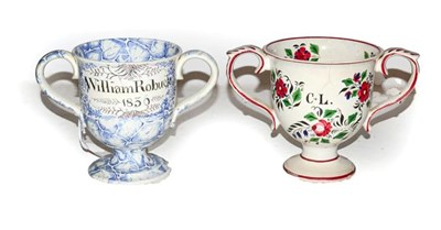 Lot 3 - Two 19th century Yorkshire pottery loving cups, possibly Killnhurst, one moulded with a frog to the