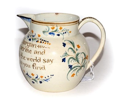 Lot 4 - An early 19th century English pearlware documentary jug, painted in underglaze coloured enamels and