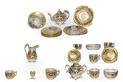 Lot 13 - A 19th century English porcelain tea set with lavish gilt decoration, impressed M H & Co (one tray)