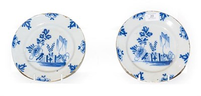 Lot 20 - A pair of 18th century English Delft blue and white pancake plates painted with chinoiserie...