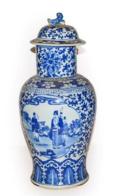 Lot 23 - A 19th century Chinese blue and white vase and cover, painted in underglaze blue with panels of...