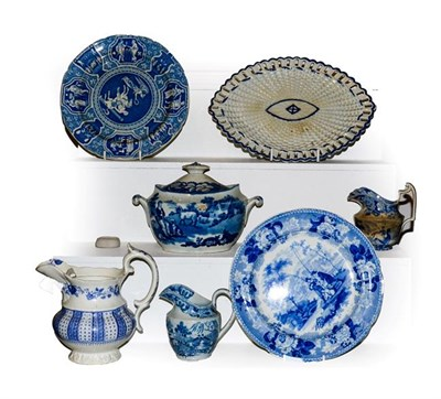 Lot 26 - A quantity of early 19th century English blue and white pottery including pearlware navette...