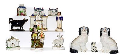 Lot 29 - A collection of 19th century Staffordshire pottery including a pearlware figure titled Rural,...