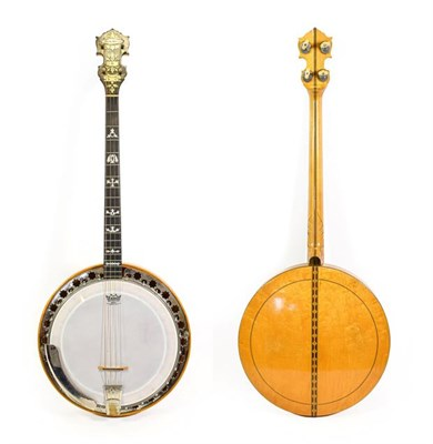 Lot 3033 - Bruno Royal Artist Four String Banjo 11'' head, 19 fret, 24 lugs, removable wooden resonator,...