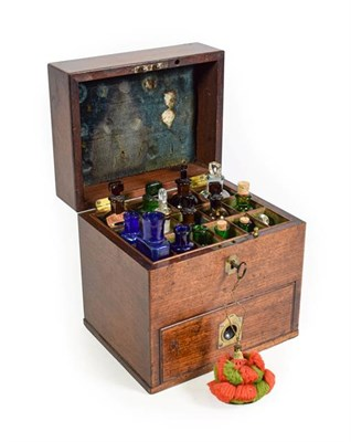 Lot 3089 - Apothecary Chest mahogany case with top section containing 15 assorted bottles and lower drawer...