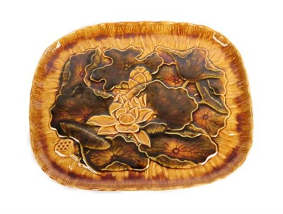 Lot 1008 - Christopher Dresser (Scottish, 1834-1904) for Linthorpe Pottery: A Tray, decorated with water...