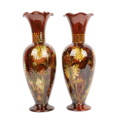 Lot 1009 - A Pair of Linthorpe Pottery Vases, shape 2219, decorated by Clara Pringle with daisies in a mustard