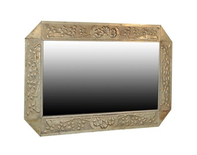 Lot 1034 - A Scottish Arts & Crafts Rectangular Patinated Metal Mirror, bevelled plate within repoussé...