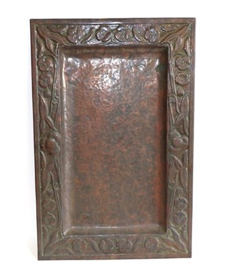 Lot 1035 - A Scottish Arts & Crafts Rectangular Copper Tray, repoussé decorated with flower heads and...