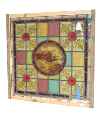 Lot 1038 - An Arts & Crafts Stained Glass Panel, the central roundel painted with a swallow and butterfly,...