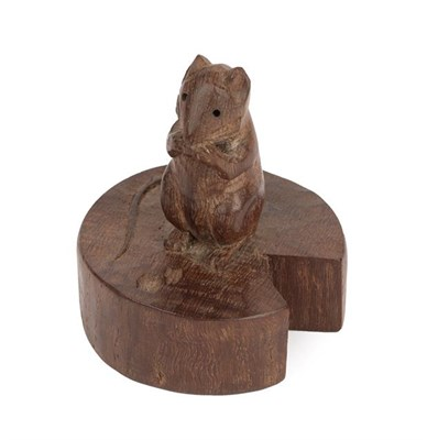 Lot 1048 - Robert Mouseman Thompson (1876-1955): An English Oak Mouse on a Wedge, the mouse carved on it's...