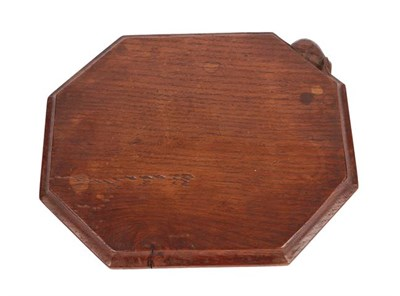Lot 1051 - Robert Mouseman Thompson (1876-1955): An English Oak Bread Board, of canted rectangular shape, with