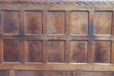 Lot 1054 - Robert Mouseman Thompson (1876-1955): An English Oak 5ft Panelled Bedstead, penny moulded top, with