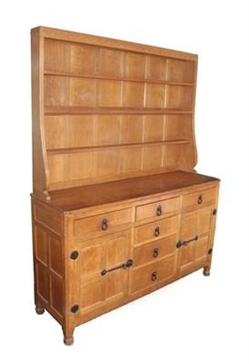 Lot 1055 - Workshop of Robert Mouseman Thompson (Kilburn): An English Oak Panelled 5ft Welsh Dresser, the open