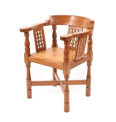 Lot 1063 - Workshop of Robert Mouseman Thompson (Kilburn): An English Oak Monk's Chair, with curved back...