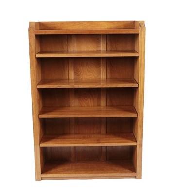Lot 1070 - Workshop of Robert Mouseman Thompson (Kilburn): An English Oak 4ft Open Bookcase, solid ends...