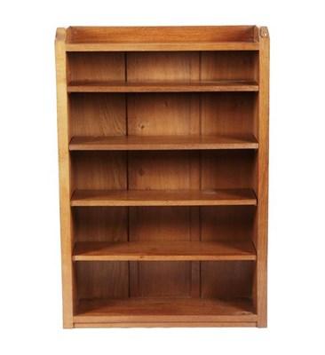 Lot 1071 - Workshop of Robert Mouseman Thompson (Kilburn): An English Oak 4ft Open Bookcase, solid ends...