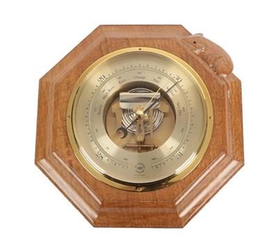 Lot 1081 - Workshop of Robert Mouseman Thompson (Kilburn): An English Oak Barometer, the octagonal frame...