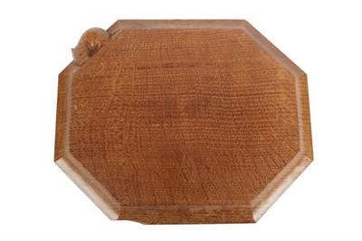 Lot 1088 - Workshop of Robert Mouseman Thompson (Kilburn): An English Oak Bread Board, of canted...