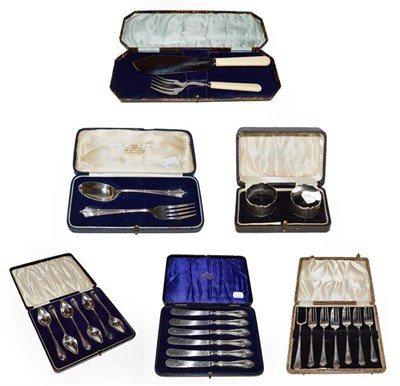 Lot 34 - A pair of silver napkin rings, a set of six silver handled tea knives, a silver two piece...