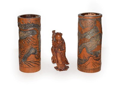 Lot 41 - Chinese boxwood figure of Shao Lao together with a pair of Japanese bamboo brush pots (3)