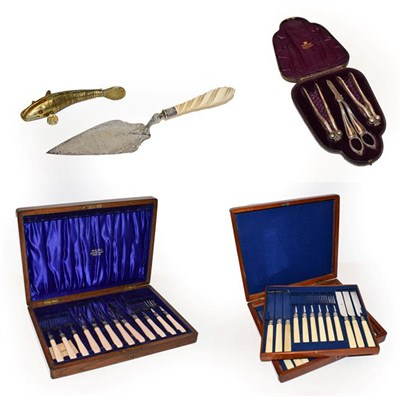 Lot 58 - A cased set of silver plated fish knives and forks, another set of fruit knives and forks, a...