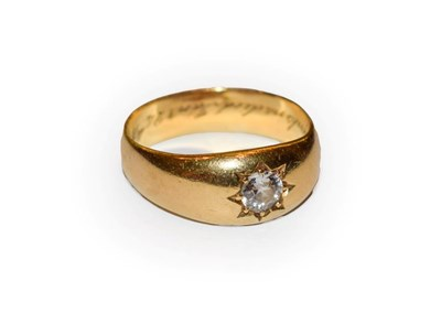 Lot 64A - A diamond solitaire ring, the old cut diamond in a yellow star setting on a plain polished...