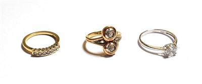Lot 66 - A diamond two stone ring, stamped '585', finger size K1/2, a 14 carat gold cubic zirconia solitaire
