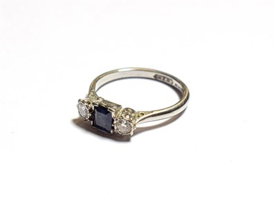 Lot 67 - A sapphire and diamond three stone ring, stamped 'PLATINUM', finger size M1/2