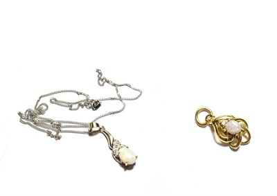 Lot 78 - A 9 carat white gold opal pendant on a trace link chain, pendant length 2.7cm, chain length 45.5cm