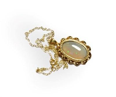 Lot 80 - A 9 carat gold opal pendant on chain, pendant length 3.0cm, chain length 41cm