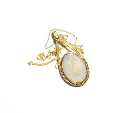 Lot 81 - A 9 carat gold opal pendant on a fine trace link chain, pendant length 3.9cm, chain length 45.5cm