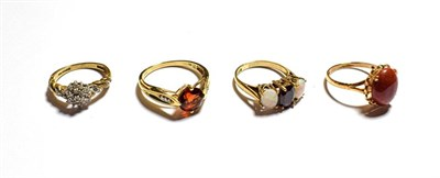 Lot 82 - A 9 carat gold opal and garnet three stone ring, finger size K1/2, a 9 carat gold chalcedony...