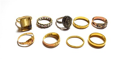 Lot 85 - Two 22 carat gold band rings, one of of shape, two 18 carat gold gem set rings (a.f.), a 9...