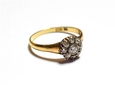 Lot 92 - A diamond cluster ring, the central old cut diamond within a border of smaller old cut diamonds, in