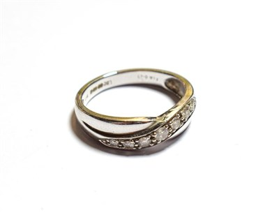 Lot 94 - A 9 carat white gold diamond twist ring, finger size N